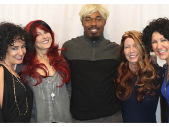 Attendees sporting their wigs